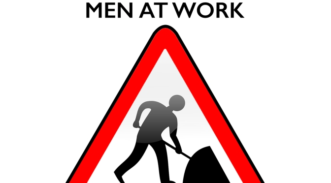 CAUTION – Men At Work!
