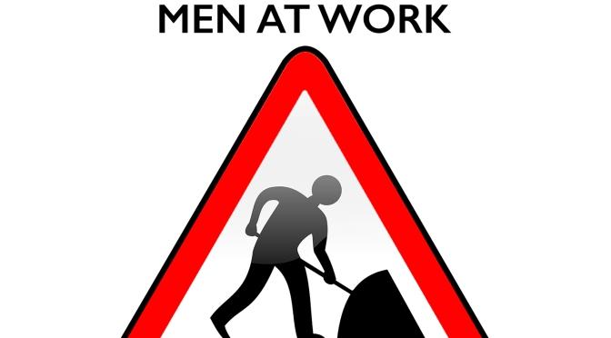 CAUTION – Men At Work!